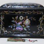 82. Papier mache tea caddy. 19th century